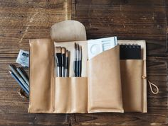 """The Sketchbook Case is made of quality vegetable tanned leather. Easy to organise all your art supplies including pens, pencils, brushes, color palette and your sketchbook in one place. Brush Case, Drawing Case, Pencil Case Material: - Vegetable tanned Leather (1.2 - 1.6 mm thickness) - YKK metal zippers - Wooden Button - Waxed thread Size: Closed - 243 mm (H) x 195 mm (W) - 9.6 """" (H) x 7.7 """" (W) Opened - 243 mm (H) x 390 mm (W) - 9.6 """" (H) x 15.4 """" (W) Details: - 100% handcrafted, made to…"""