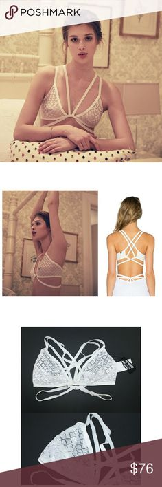 """FLASH SALE NWT For Love & Lemons Lace Bondage Bra New with Tags sheer white diamond lattice bondage bralette by For Love & Lemons Skivvies. Size Small. No underwire. Sexy strappy look. Back closure. No dustbag. Elastic band with some stretch (measurement laid flat across - 12"""").   84 % Nylon, 5% Rayon and 11% Spandex   No Trades/No PP/No Mercari/No Modeling. For Love and Lemons Intimates & Sleepwear Bras"""