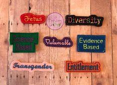 7 #words the CDC cant say #embroidered #felt #pins. Link to #etsyshop in bio! #resist #resistance #riseup #handmade #feltcraft #embroidery #crafter #craftlife #etsyseller #etsy #transgender #diversity #fetus #scienceisreal #evidencebased #entitled #tomboytogs