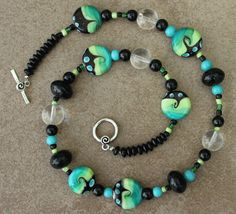 Green and black lampwork beaded necklace by 3DJewelry4U on Etsy, $28.00