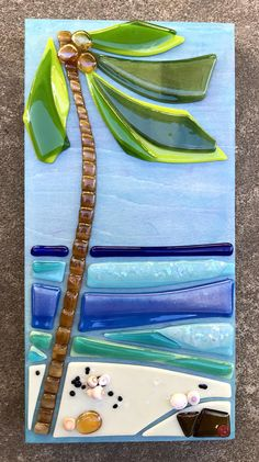 "Coconut Beach This Coconut Beach"" mixed media art is part of my new Aloha Blocks"" wall series. Fused glass swaying coconut tree, colorful and sparkly crashing ocean waves, and shell scattered pristine white sand beach with lava rocks stand out on a beautiful blue sky and sea background."