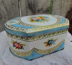 Vintage biscuit tin in baby blue and roses