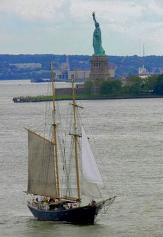Statue of Liberty w/boat by T.C.