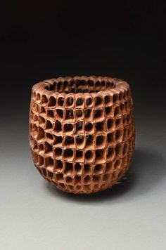 """Andi Wolfe, wooden basket Wolfe is  a botanist and a part time wood turner, who employs botanical motifs and   """"emulate[s] the work of Grinling Gibbons - the master carver from the 17th and 18th centuries."""""""