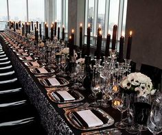 Single Long Table With Black And White Damask Linens Silver Square Chargers Crystal Candelabrum Taper Candles