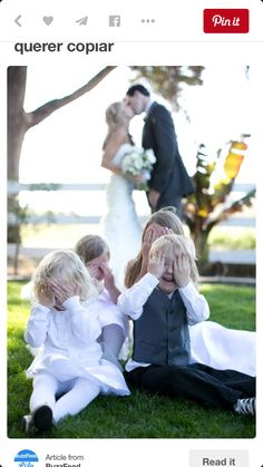 a childish photo (representing the family well) of the kids closing there eyes grossed out as the parents kiss in the background. A+++