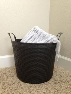 Pinner found these sturdy plastic woven totes in the garden section at Walmart for only $4.97 (regular price)! Perfect for blankets, toys, small hamper, etc. More details and storage ideas in blog post and tour of her home.