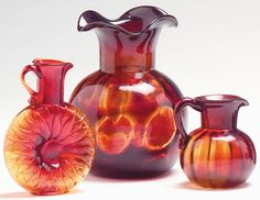 Three piece glass groupclevenger brothers glass works clayton new jersey pre-1960Including an amberina Bulls-eye vase, amberina Sunflower pitcher and an amberina Chubby creamer.Tallest 8 1/2 in.