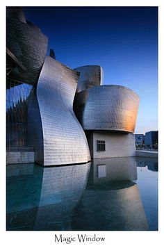 Magic Window by Örvar Atli                          The random shapes of the Guggenheim Museum in Bilbao, Spain are amazing. Somehow the black window on the wall is reflected as white in the water!