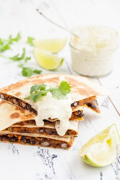 Vegan Sweet Potato Quesadilla Recipe - With black beans, smoked paprika and coriander and ground cumin, these vegan sweet potato quesadillas are hearty and packed full of flavour. Serve with a generous dollop of lime cashew cream and an extra squeeze of lime along with a side salad for a delicious weeknight dinner.   Click to get the recipe