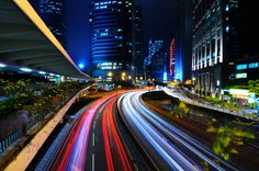 I love light trails from long exposure photos...this is a really beautiful shot of Hong Kong