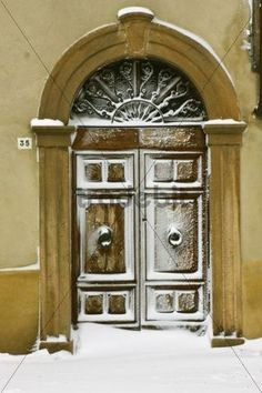 Snow-covered front door in Pienza Tuscany Italy Europe