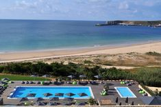 Martinhal Beach Resort & Hotel - Hotel Martinhal: Bean bags on dark decking, plus ginormous plant pots filled with spikeys
