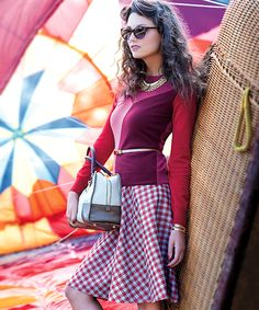 Loving the mid century meets modern trend for this fall -- that Prada skirt is perfect!