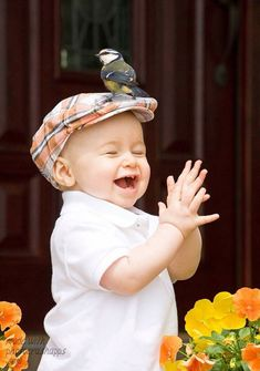 Smile and be happy :) What a picture! I wonder how they got that bird to sit on his hat?