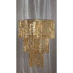 Our gold chandelier is made of thousands of carefully detailed metallic mylar strands with chrome hanging chains.
