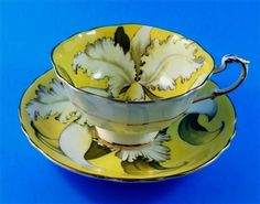 White-Orchid-on-Yolk-Yellow-Paragon-Tea-Cup-and-Saucer-Set