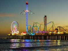 Galveston Island Historic Pleasure Pier at night. This took the place of the Flagship Hotel after it was damaged beyond repair during hurricane Ike.