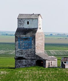 The long abandoned United Grain Growers elevator in Farrow, Alberta. It and the rest of the ghost town of Farrow including school/church house were torched by fire and cleared to make room for more crops. Abandoned Houses, Abandoned Places, Country Scenes, Old Farm, Horse Barns, Old Buildings, Ghost Towns, Watercolor Landscape, Landscape Photos
