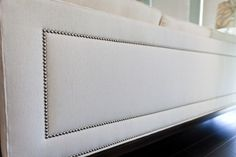 naialhead trim on back of a couch.. yes pls!