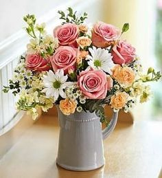 Charming Wishes Bouquet Send someone special a charming surprise for any reason… or no reason at all! This simple yet stylish arrangement of pink roses, white daisy poms, orange mini carnations and mo