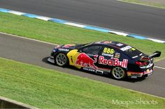 Craig Lowndes in his Red Bull Racing Australia Holden Commodore at Eastern Creek, Sydney NSW during per 2013 season V8 Supercars testing.