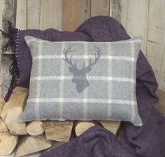 A beautiful, soft coloured Irish tweed & linen cushion with a hand-printed stag's head motif. It looks equally stunning placed on a chair, or sofa, alone or Stag Cushion, Chalet Chic, Arrow Decor, Luxury Cushions, Stag Head, Country Crafts, Living Room Carpet, Rustic Charm, Decoration