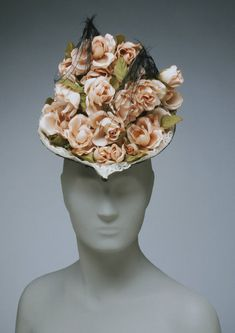 Woman's Hat  Geography: Made in England, Europe Date: Restyled c. 1943 Medium: Black straw, lace, feathers and pink silk roses  Accession Number: 1993-12-1