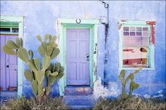 Photograph of colorful blue American Southwest wood door with blue adobe wall. Large wall art décor door photography in sizes 11x14 16x20 16x24 20x30 24x36 32x48 as a gallery wrapped canvas or print. Image title: Adobe Blue Wall This image is from my photography series of colorful Southwest doors and was taken in the barrio area of Tucson, Arizona These buildings are over 100 years old and the adobe walls are very thick to keep the buildings cool from the desert heat. All photographs are...