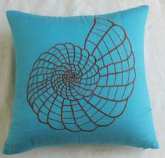 turquoise blue throw pillow with brown shell embroidery
