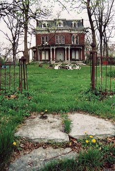Old Farm Mansion: I can almost see decades and decades of children and parents happily walking through that gate to travel to town..or exciting places like a World's Fair. Oh, if I could afford to buy and renovate that home. IT DESERVES IT.