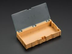 For storing small parts (especially SMT/SMD components), these little modular boxes are ideal. They have individual clear pop-open covers so you can keep only the ones you want open - less risk of mixing up parts or having a spill. Electronics Projects, Electronics Storage, Storage Containers, Storage Boxes, Smartphone, Tool Organization, Diy Storage, Orange, Ebay
