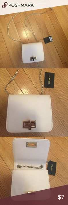 Cream crossbody bag Cute bag great for weddings and other events. Never been used, still has the tags attached. Forever 21 Bags Crossbody Bags