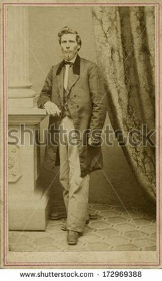 CIRCA 1865 - A vintage Cartes de visite photo of a gentleman. The man is standing with one arm on a post. A photo from the Civil War Victorian era. A digital copy can be purchased at the above web link.
