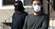 a person wearing a mask: Oko Carter, left, and Andres Vidaurre share a home Los Angeles with eight other people. Laguna Woods, Healthcare News, Hermosa Beach, New Mobile, Normal Life, Venice Beach, Adult Children, Losing Her, Long Beach