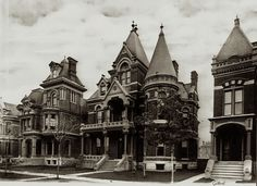 "Frost House in Brush Park, Detroit  The George S. Frost House (center) with it's original neighbors in Brush Park, Detroit. The entire row of stunning Victorian mansions is now gone. This photograph is from the ""Burton Historical Collection."""