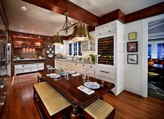 Image from http://betterhomelifestyle.com/photos/White-Wood-beam-beams-bin-pulls-brass-pendant-brick-backsplash-copper-vent-hood-dark-wood-kitchen-table-eat-in-kitchen-exposed-brick-glass-front-cabinets-inset-cabinets-oriental-rug-pa.jpg.