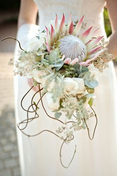 Love this King Protea wedding bouquet. Feels wild and enchanted! | SouthBound Bride |