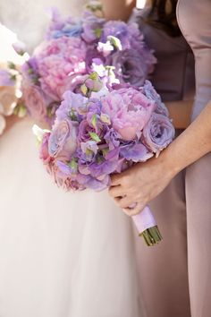 Pretty shades of purple and lilac loved by the Wedding and Event Institute #weddingflowers #wedding #lilac
