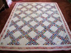 """1920's feedsack quilt, 1"""" squares completely hand sewn and quilted!  So amazing!!"""