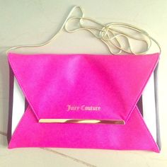 Juicy Couture Clutch Brand New Juicy Couture clutch. Hot pink with black and white edges. Golden chain. Juicy Couture Bags