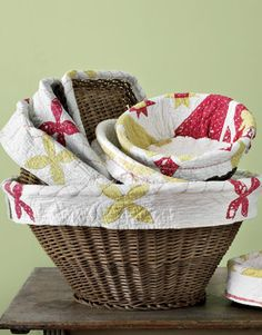 Fabric-Lined Baskets  Have a lovely (but stained or damaged) quilt? Give the keepsake new life as a basket liner, or use smaller pieces of fabric to create a border of decorative trim. Choose any medium- to heavyweight remnant, such as upholstery fabric or thick muslin, that you may have on hand. Deep baskets keep table linens or towels tidy; a shallow basket corrals desktop items.