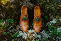 Brown tan shoes with green laces.