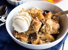 Mama's Bread Pudding 2 C homemade biscuits, crumbled 4 C milk 2 eggs 3/4 C sugar 1/4 tsp salt 1/4 tsp cinnamon 1 tsp vanilla 1/3 C raisins 3/4 C coconut Layer biscuit crumbs, coconut, and raisins twice, ending with another layer of crumbled biscuits. Mix remaining ingredients together. Pour over biscuit layers. Sprinkle with two tablespoons of sugar. Bake at 350 for one hour. Serve hot with ice cream!