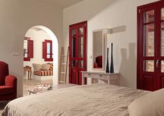 wooden windows with color ral and wood meranti, hotel in Folegandros, Greece