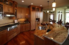 kitchen         Charles Cudd DeNovo Available Homes   Bridgewater Lake Medina	 Back to Listings  Medina, MN  SOLD   4455 Bluebell Trail South   Medina, MN | Map  Community: Bridgewater Lake Med     Square Ft: 3765	Bedrooms: 3  School District:     Wayzata	Baths: 2 1/2  $829,800  THERE IS A PENDING SALE ON THIS HOME: This stunning prairie home includes a kitchen with custom cherry cabinetry & curved center island, window filled interior, main level study with cherry beams & trim,