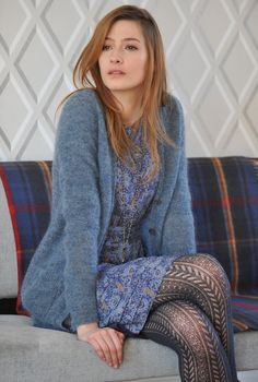 This floral dress pairs perfectly with the patterned tights.  And the fuzzy cardigan complements so nicely.  Great outfit all around!