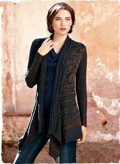 An elegant jacket alternative, our drapy cardigan juxtaposes an Asian floral with plaited ribs that resemble the organic texture of tree bark. The contemporary design is jacquard knit with a cascading shawl collar and an angular hem.