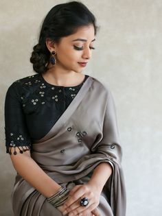 Latest Traditional Blouse Designs - The Handmade Crafts Black Blouse Designs, Traditional Blouse Designs, Saree Blouse Neck Designs, Blouse Patterns, Black Saree Blouse, Pattern Blouses For Sarees, Indian Blouse Designs, Kerala Saree Blouse Designs, Grey Blouse