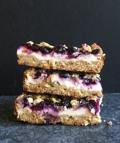 Super portable and gently sweetened with just a bit of brown sugar and maple syrup, these yogurt bars are a cinch to make and can do double duty as a delicious (and healthful) breakfast replacement, or a satisfying afternoon snack. Tart blueberries are the perfect foil for a thick layer of yogurt and a tender, cinnamon-scented crumble—but raspberries or blackberries will also work in a pinch.